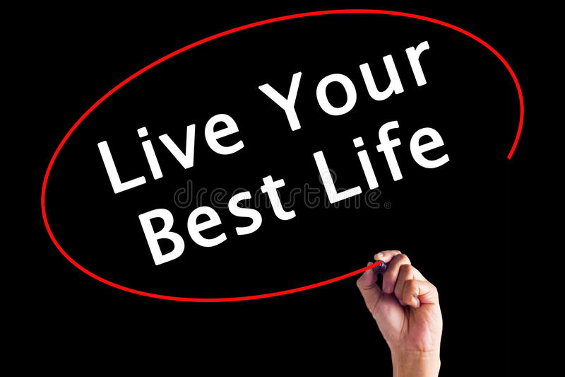 Main écrivant Live Your Best Life avec un marqueur photos stock