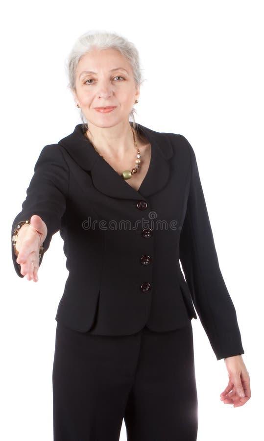 Main aînée de secousses de femmes d'affaires photos libres de droits
