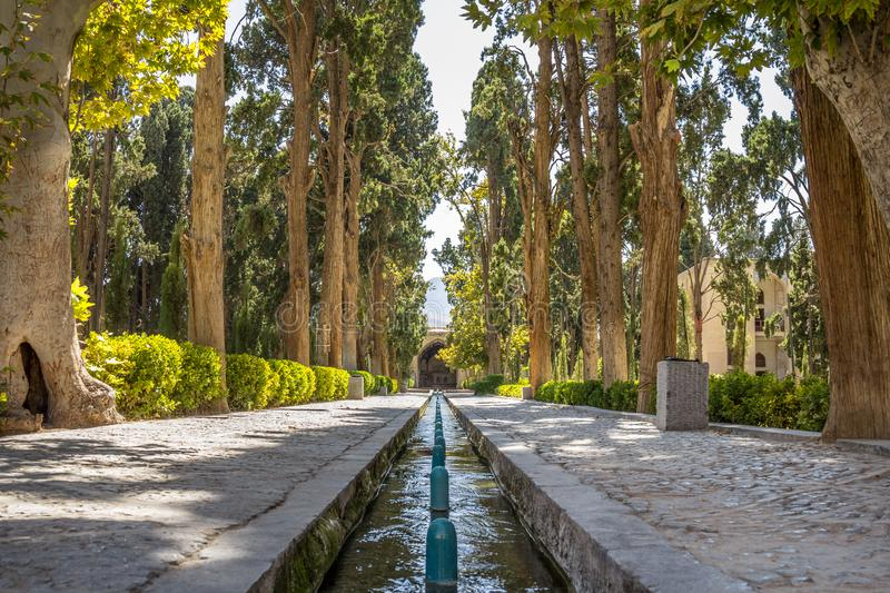 Main alley of the Kashan Fin Garden, also known as Bagh e Fin park. It is a touristic landmark of Kashan, Iran. Main street of the Bagh e Fin Garden, surrounded royalty free stock photos