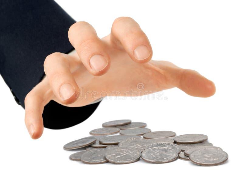 Main atteignant pour des pièces de monnaie image libre de droits