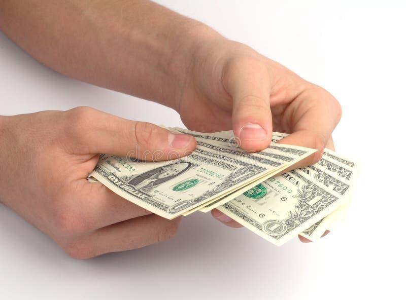 Main avec de l'argent image libre de droits