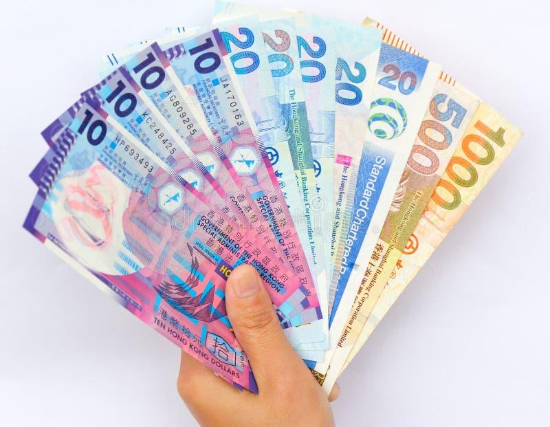 Main avec des dollars de Hong Kong photographie stock libre de droits