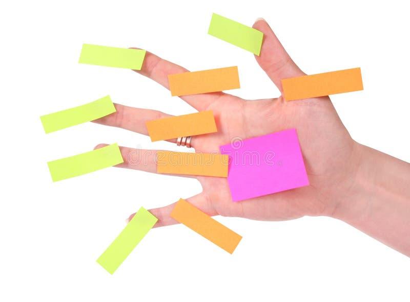 Main avec des notes de post-it images libres de droits
