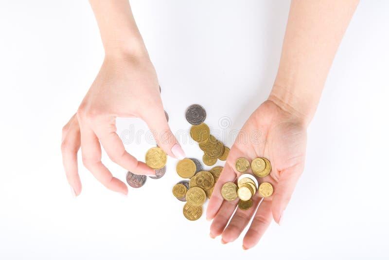 Main avec des pièces de monnaie photographie stock libre de droits