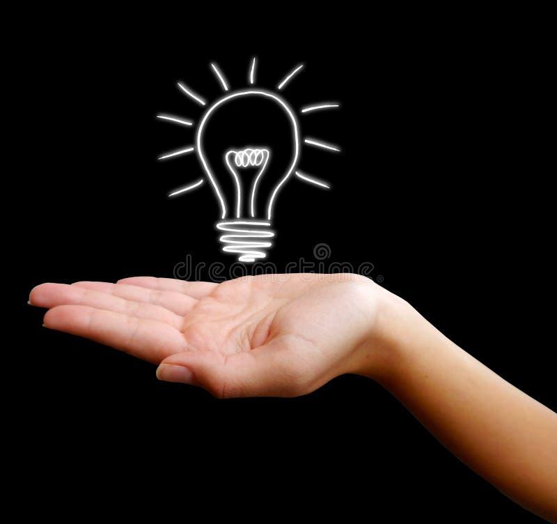 Main avec l'ampoule ou le globe photos stock