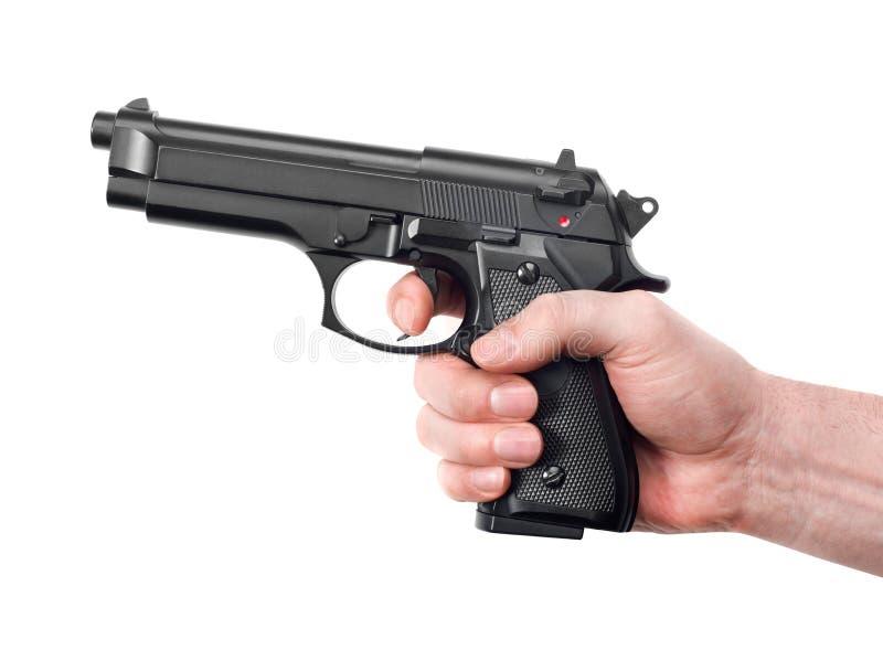 Main avec l'arme à feu photos stock