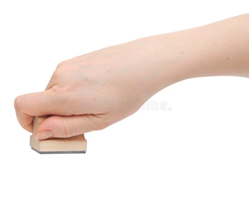 Main avec l'estampille photographie stock