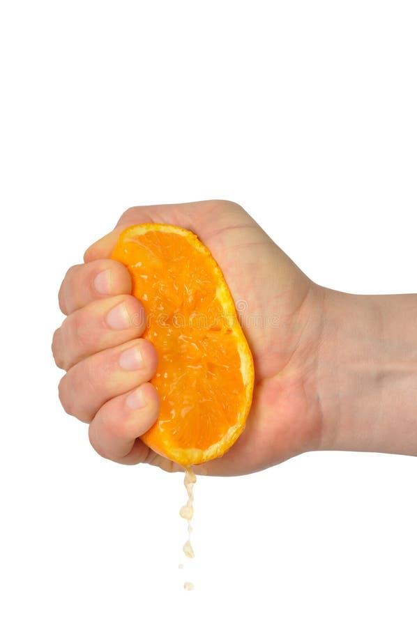 Main avec l'orange photographie stock