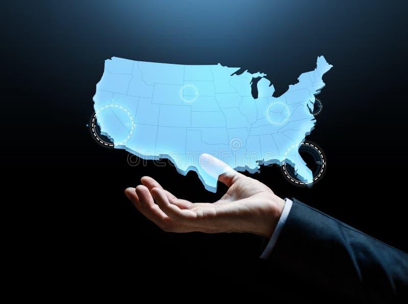 Main avec la carte des Etats-Unis d'Amérique image libre de droits