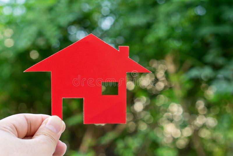 Main avec la forme de maison Nouvelle maison image libre de droits