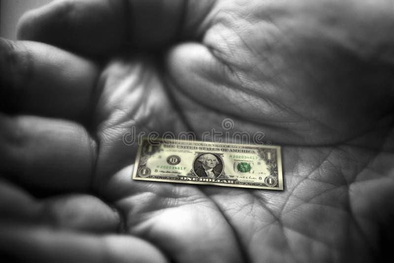 Main avec la note du dollar image stock