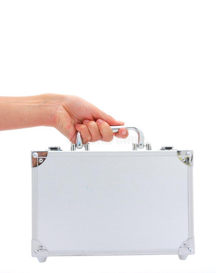 Main avec la valise image libre de droits