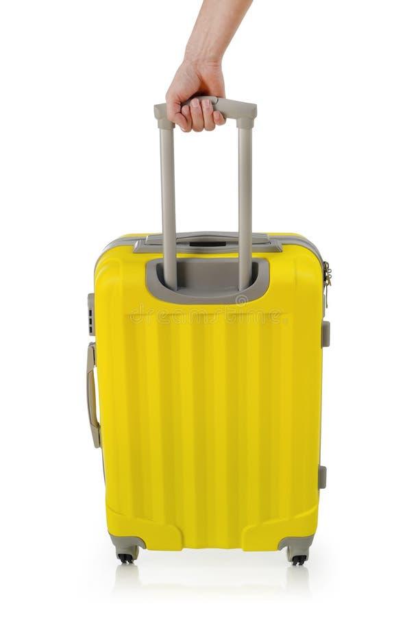 Main avec la valise image stock