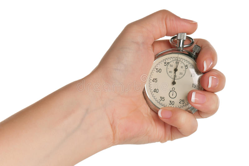 Main avec le chronomètre image stock