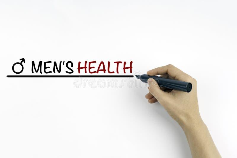 Main avec le marqueur écrivant le texte - la santé des hommes image libre de droits