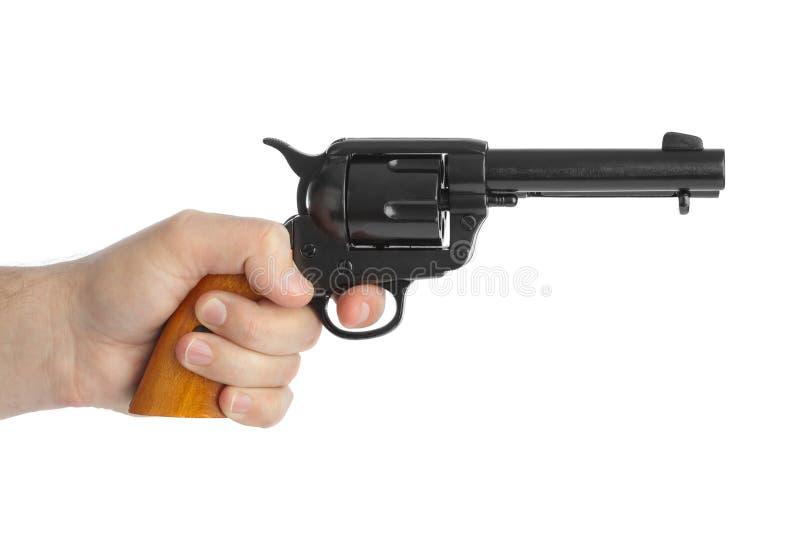 Main avec le revolver images libres de droits