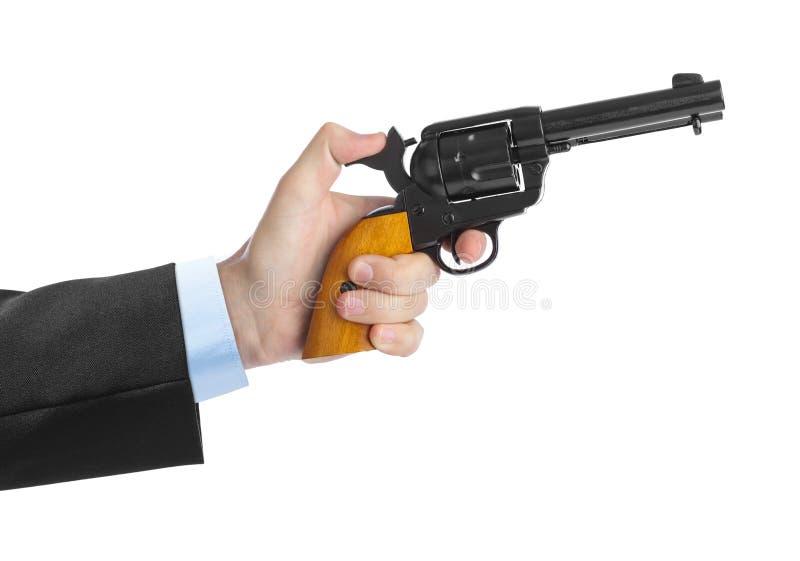 Main avec le revolver photographie stock