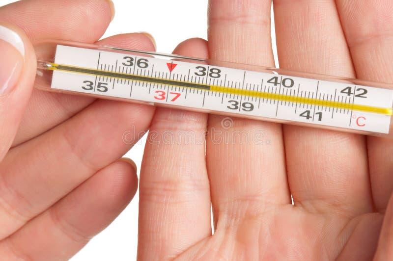 Main avec le thermomètre photographie stock libre de droits