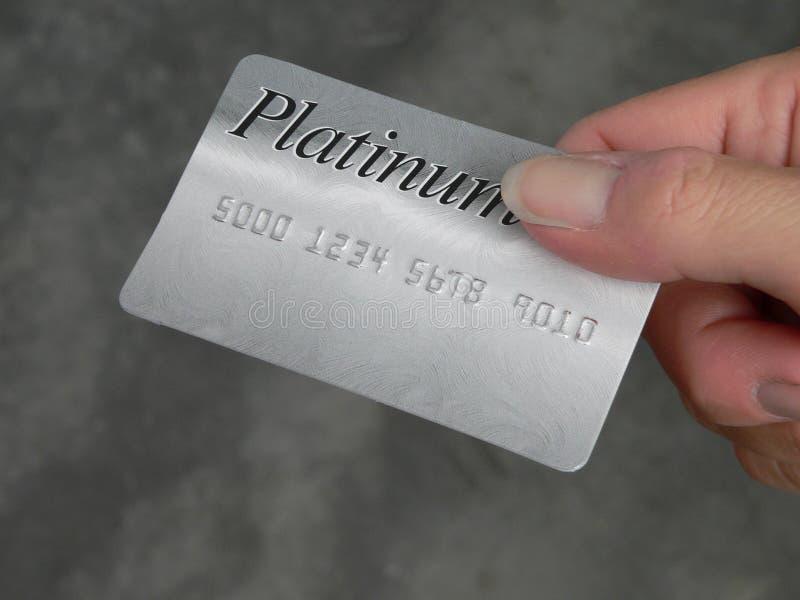 Main avec par la carte de crédit photographie stock