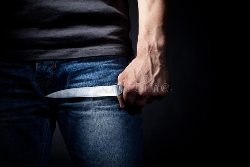 Main avec un couteau photos libres de droits