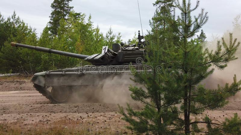 Main battle tank are going to dust on the ground for military exercises stock photos