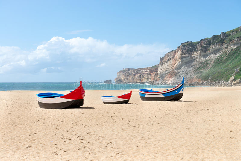 Main beach in Nazare with Traditional colorful boats royalty free stock image