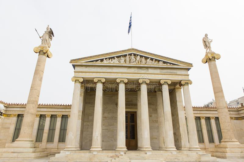 Main building from Academy of Athens. Tourist visiting the main building from Academy of Athens in Greece royalty free stock photography