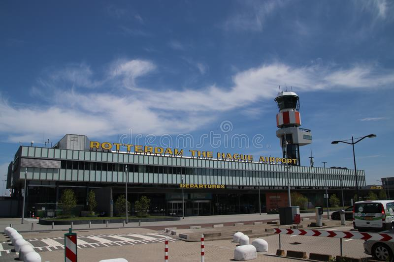 Main building for arrivals and departure of Rotterdam The Hague Airport in the Netherlands with traffic tower stock photo