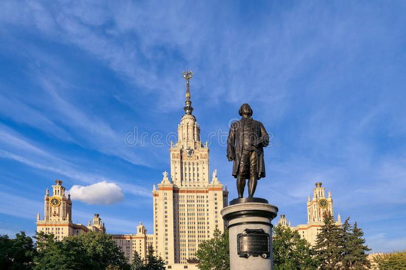 Main building and Lomonosov monument in autumn sunset campus of Moscow university under nice blue sky. Moscow / Russia - September 3 2019: Main building and stock images
