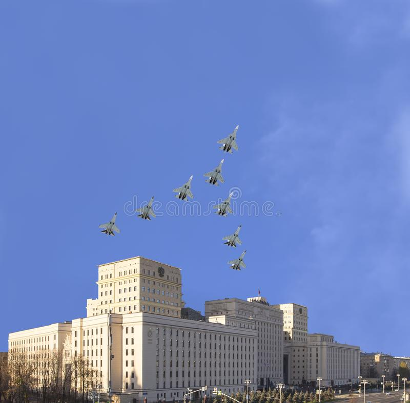 Main Building of the Ministry of Defence of the Russian Federation and Russian military aircrafts fly in formation, Moscow, Russia stock photos