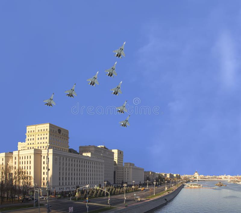Main Building of the Ministry of Defence of the Russian Federation and Russian military aircrafts fly in formation, Moscow, Russia stock image