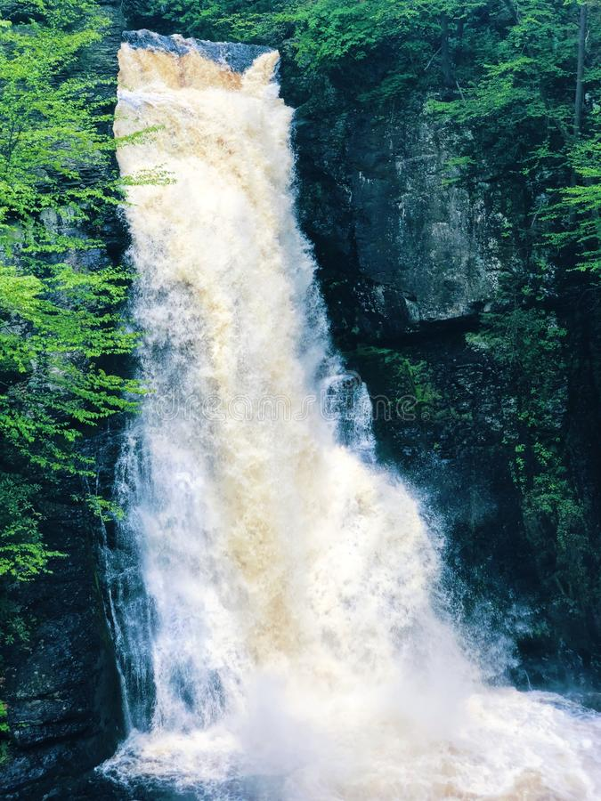 The main Bushkill Falls water flowing fast. In the summer that located in Northeast Pennsylvania`s Pocono Mountains in the United States royalty free stock images