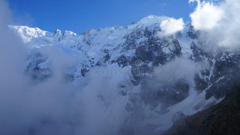 The main Caucasus ridge. View of The main Caucasus ridge from The cadet night stay (3300 m) near The heart mountain lake stock photos