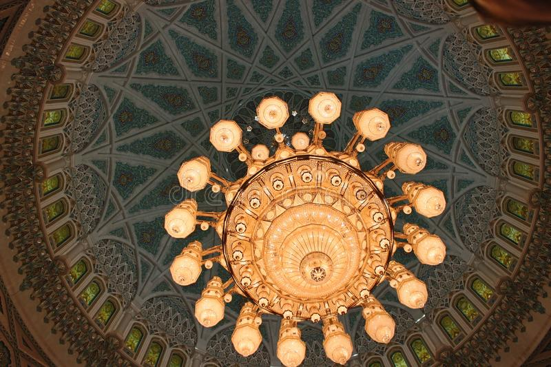 The Main Chandelier of the Sultan Qaboos Grand Mosque. The largest chandelier in the world adorns the Sultan Qaboos Grand Mosque in Muscat, Oman. It weighs 8.5 stock photo