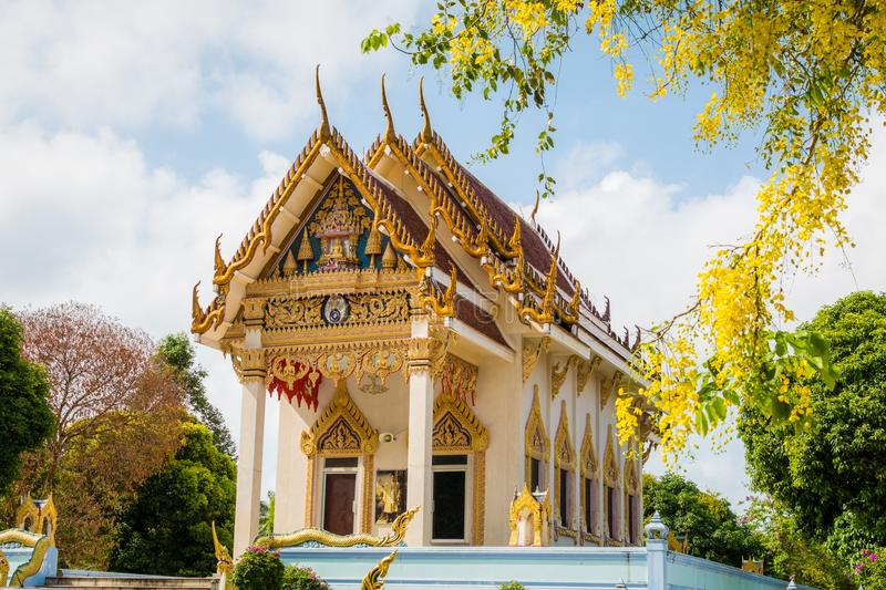 Main chapel in the buddhist temple Wat Kunaram in Koh Samui,. Main chapel in the buddhist temple Wat Kunaram with cloudy blue sky in Koh Samui, Thailand stock image