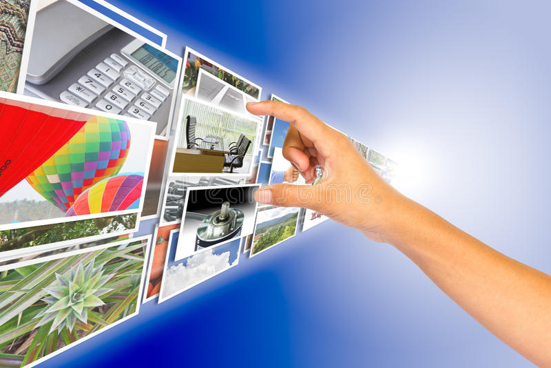 Main choisissant l'image du flot d'images photos stock
