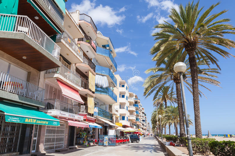 Main coastal street of Calafell resort town. Calafell, Spain - August 13, 2014: Tourists walk on main coastal street of Calafell resort town in sunny summer day stock photo