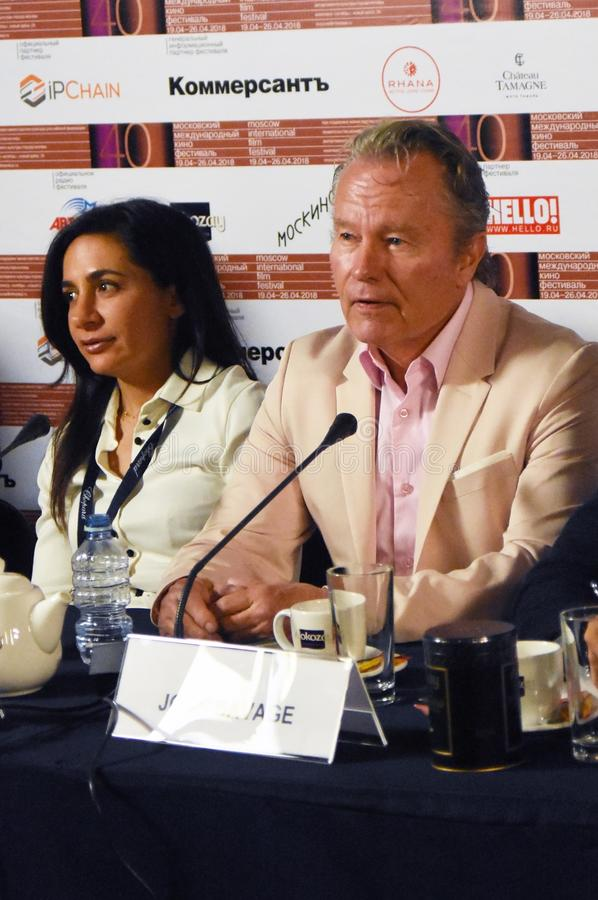 Anna Melikyan and John Savage. Main competition jury press conference of 40th Moscow International Film Festival. Date: April 20, 2018. Place: Moscow. Color royalty free stock photography