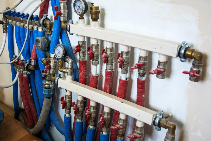 Main Control manifold of house heating system. Copper valves, stainless ball valves, detector of water and plastic pipes of central heating system and water stock photography