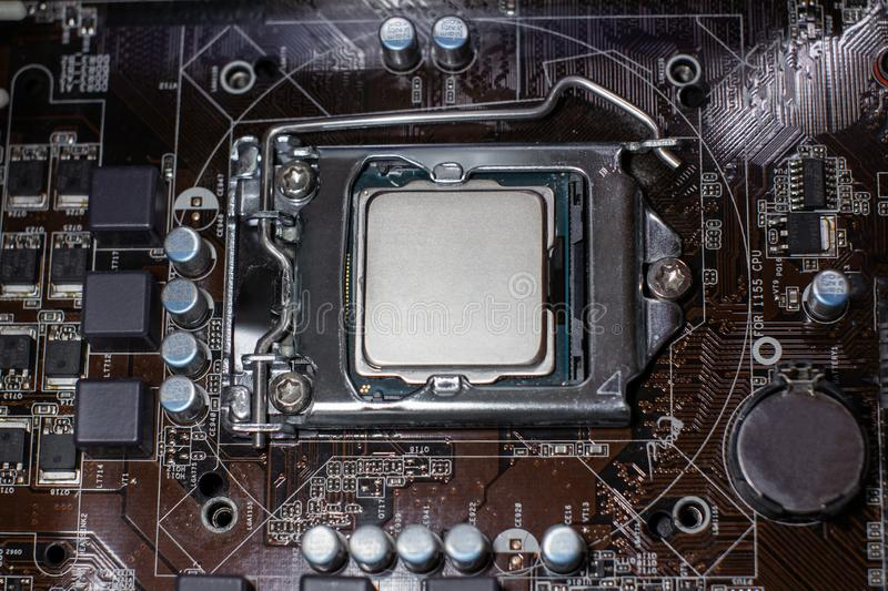 Main cpu in the socket. Concept of repairing or upgrading computer hardware royalty free stock photography
