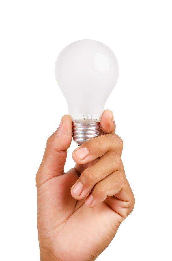 main d'ampoule retenant la lumière incandescente photographie stock