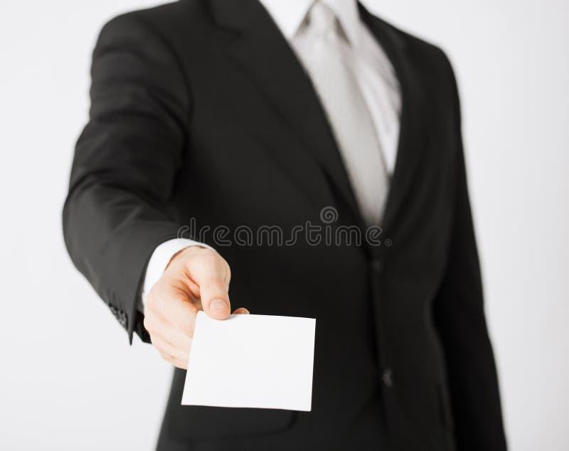Main d'homme avec le papier blanc photographie stock libre de droits