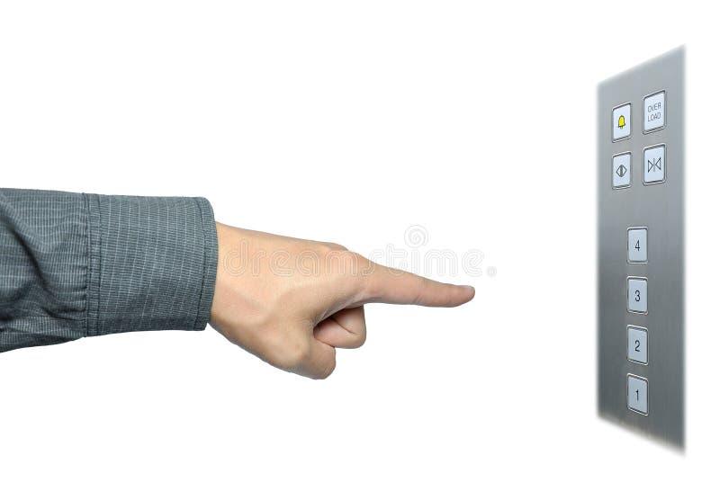 Main d'homme d'affaires au bouton-poussoir sur le levage photo stock
