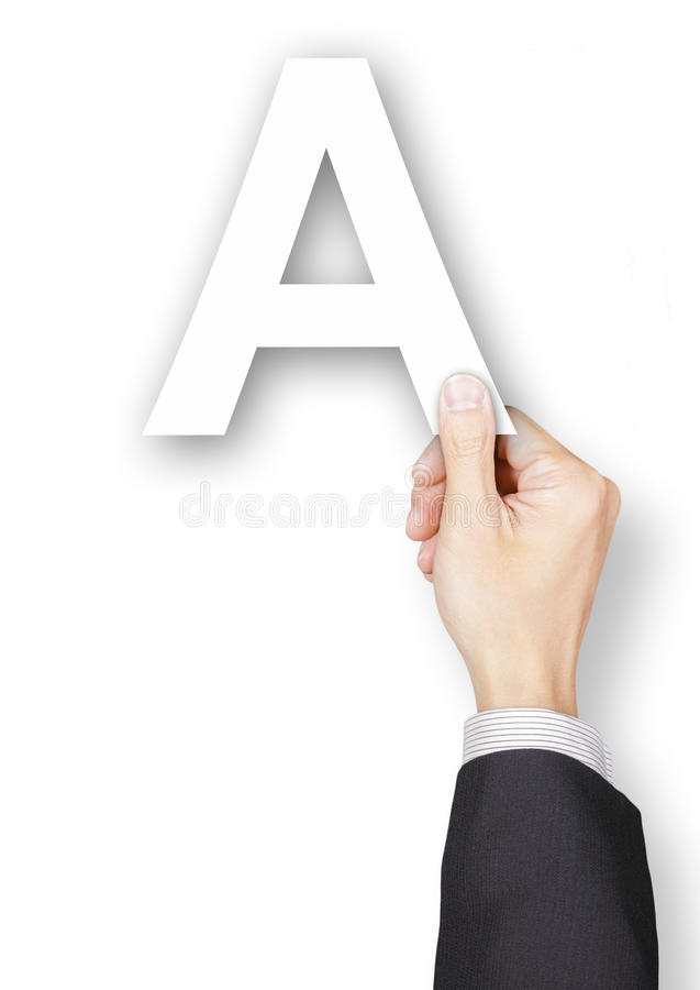 Main d'homme d'affaires tenant l'alphabet de papier A photo stock