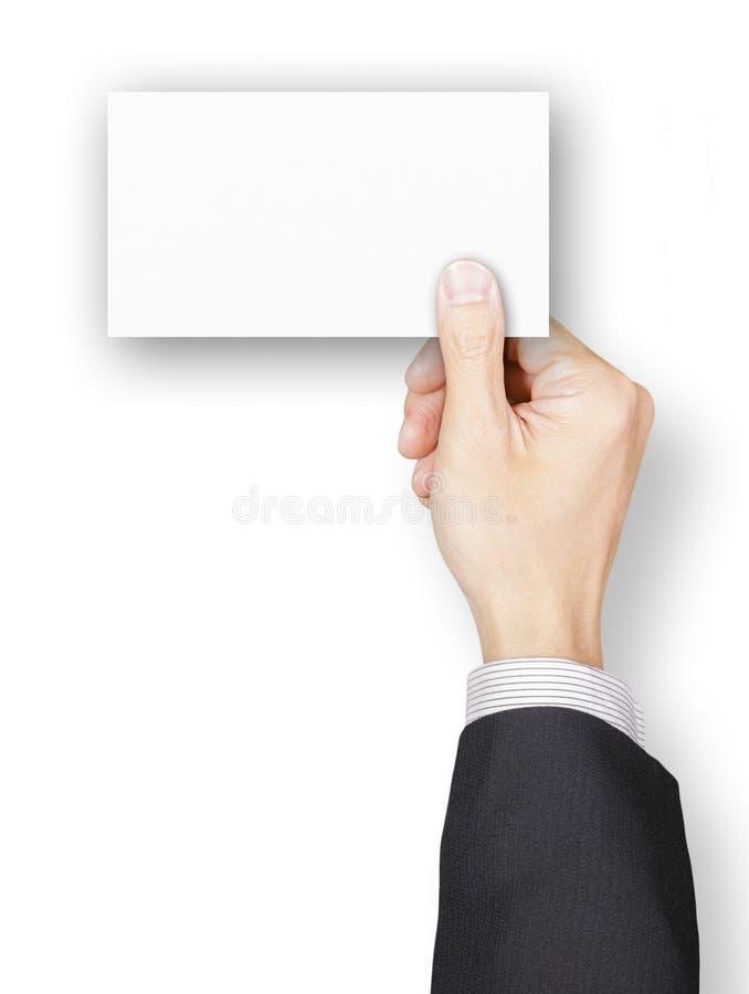 Main d'homme d'affaires tenant une carte nominative vierge image libre de droits