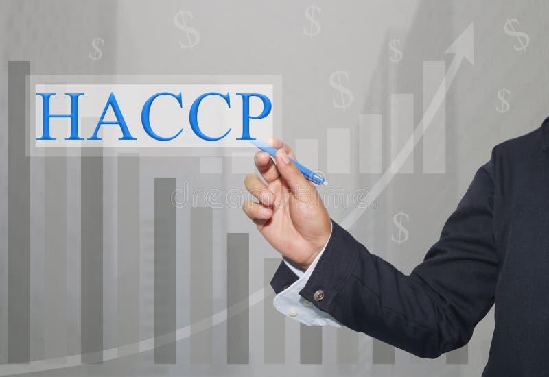 Main d'homme d'affaires Write un texte de HACCP photographie stock libre de droits