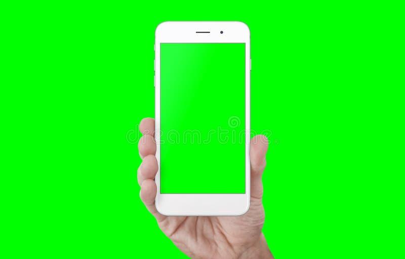 Main d'isolement d'apparence du téléphone NAD en vert, clé de chroma photo libre de droits