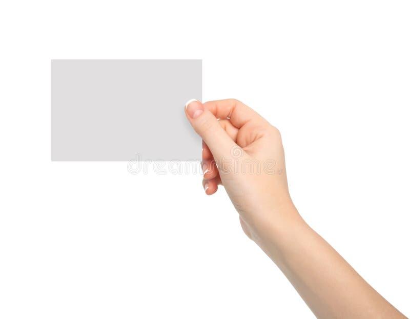 Main d'isolement de femme tenant un morceau de papier image stock
