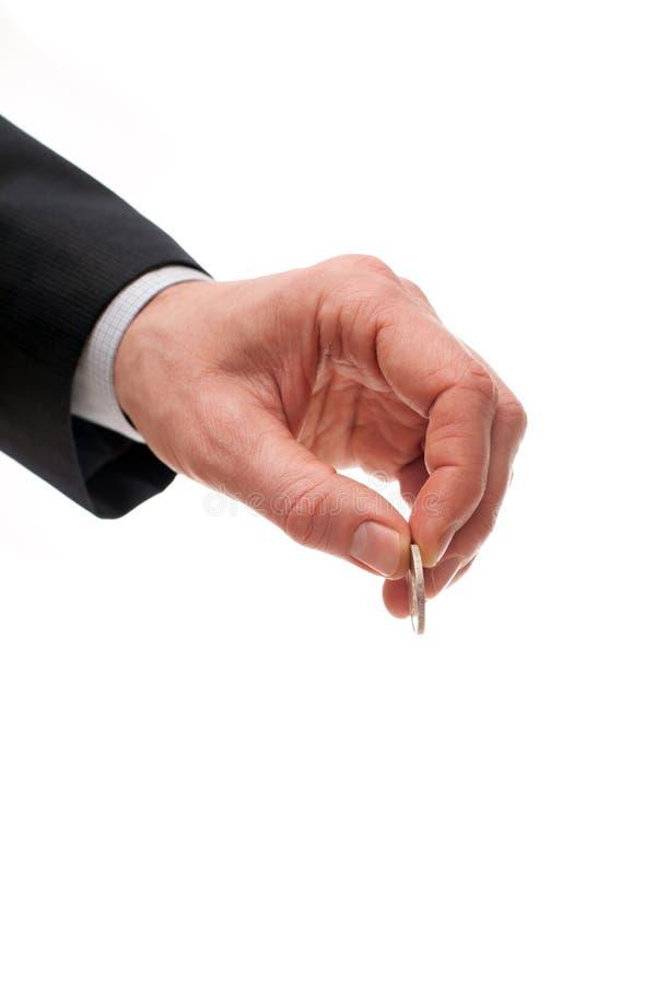 Main d'un homme d'affaires avec une pièce de monnaie images libres de droits