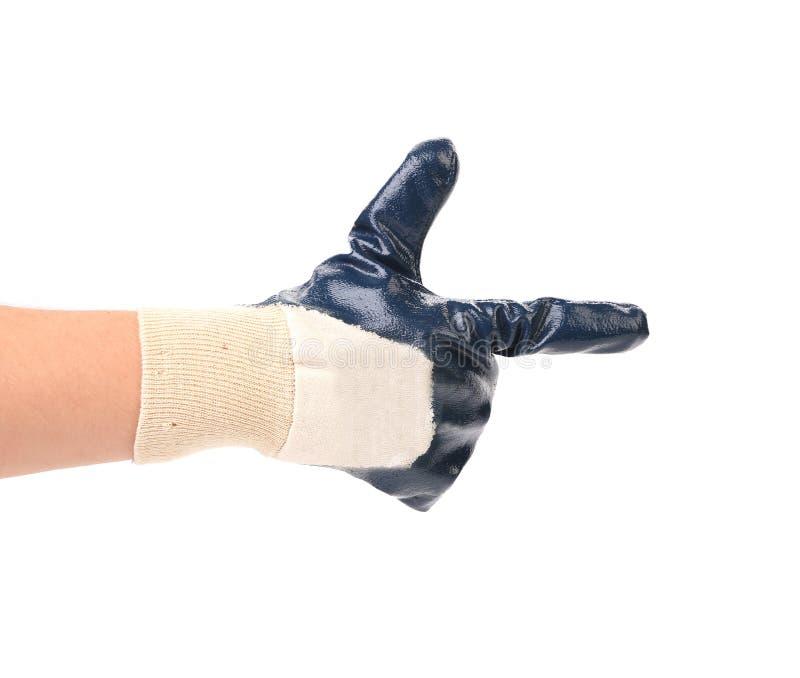 Main dans le gant comme arme à feu photo libre de droits